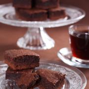 Chocolate brownies on the cake stand and cup of coffee