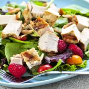 Healthy green salad with grilled chicken breast