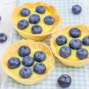 Tartlets with lemon curd and blueberries, closeup