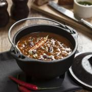 Spicy Mexican soup with beans and peppers