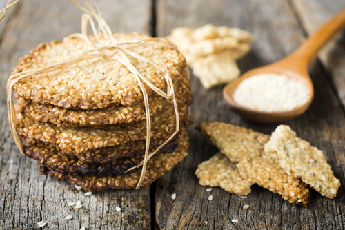 Selective focus on the sesame cookies on left side