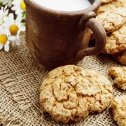 Milk and oatmeal cookies on the wooden table