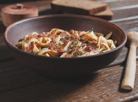 pasta tagliatelle bolognese on the wooden table