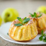 sweet apple muffins with powdered sugar and mint